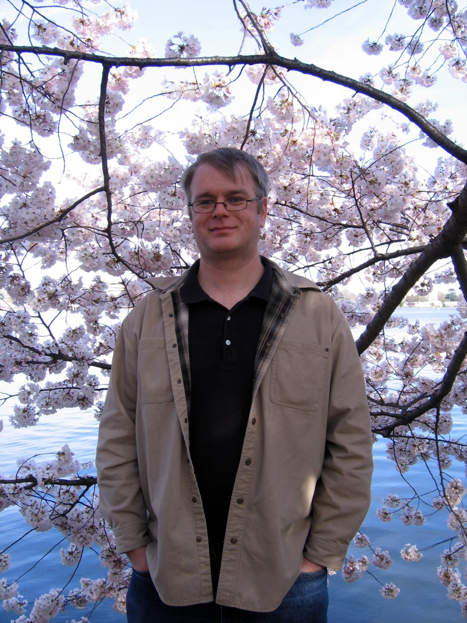 Me with a back drop of cherry blossoms.  I never look happy in pictures.